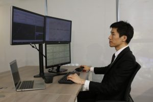 Trader With Four Monitors